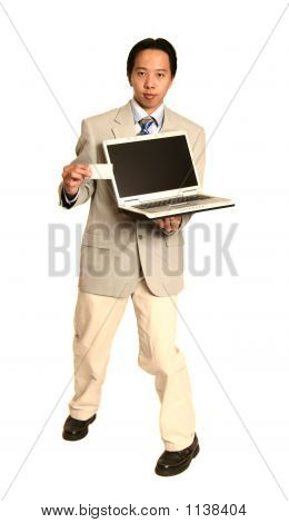 Man Holding White Card And Laptop