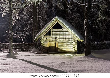 Bath house in the winter night