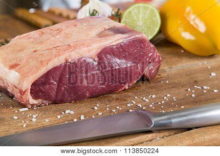 Organic Red Raw Steak Sirloin On Wooden Board