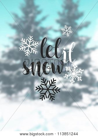 Let it snow. Blurred background with snow, trees. Christmas calligraphy