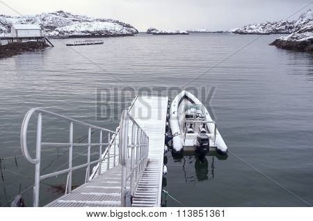 Boat On The Pier At The Lake Snow
