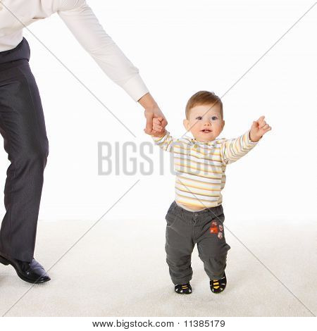 The Little Boy Hold The Father's Hand