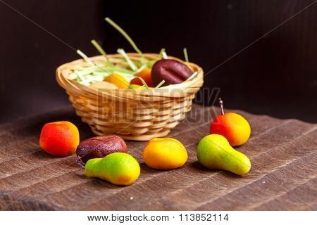 A Basket Of Chocolates From Marzipan In The Form Of Fruits Is Not A Black Table.