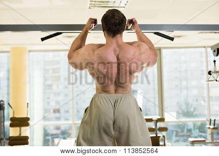 Champion doing pull-ups.