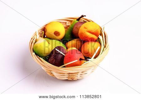 Basket With Marzipan Sweets In The Form Of Fruit On A White Table.