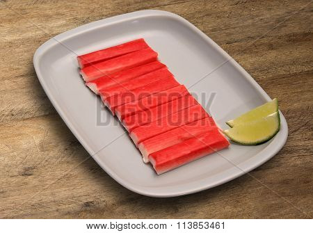 Fish Cubes On Wooden Background.