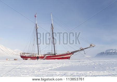 Sailboat Stranded On Sea Ice - Horizontal
