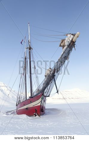 Sailboat Stranded On Sea Ice - Vertical