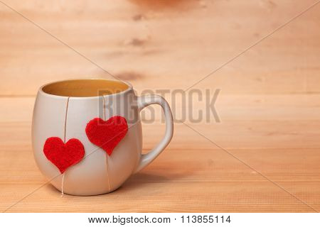 Cup of tea with hearts