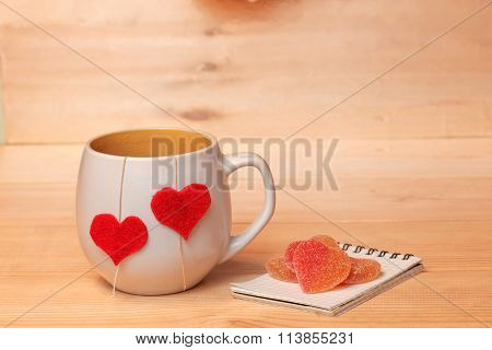 Cup of tea with hearts and candied fruit jelly