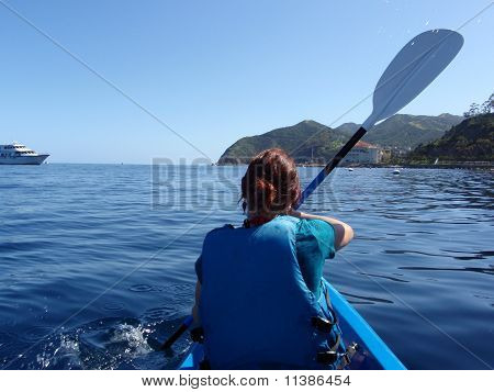 Redheaded Lady Paddles Kayak Toward Catalina Island