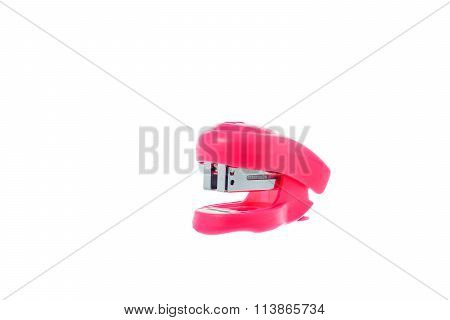A Little pink stapler on white background