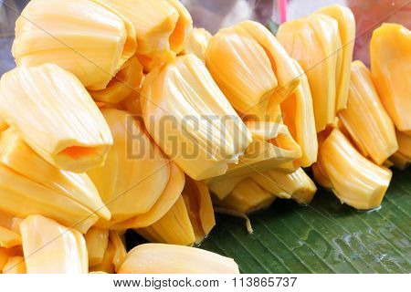 jack fruit yellow seedless pile on green banana leaf