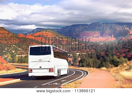 White tourists bus cornering in Sedona