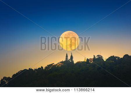 Super Moon Over Wat Phrathat Doi Suthep Temple In Chiang Mai, Thailand