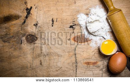 Preparation Of The Dough. Flour With Eggs And Rolling Pin .