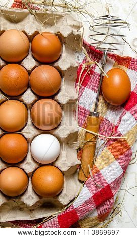 The Cassette With Eggs, Hay And Whisk On The Fabric.