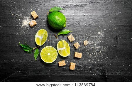 Lime Background . Limes, Sugar And Leaves.