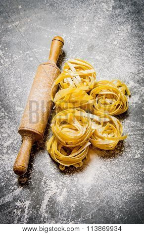 Dry Pasta With A Rolling Pin And Flour.
