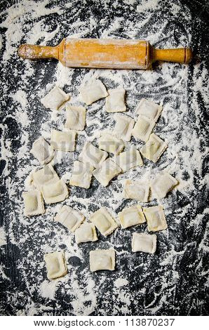 Homemade Ravioli With A Rolling Pin In Flour.