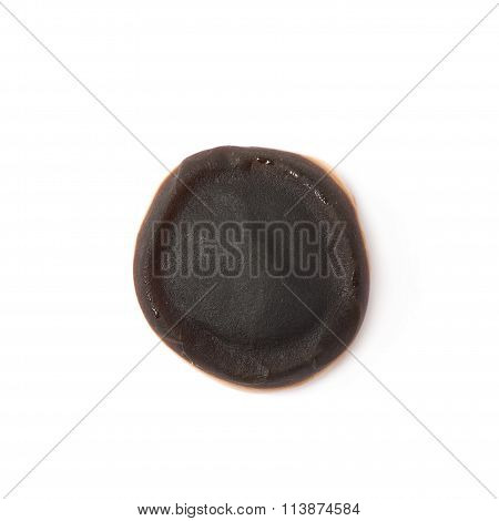 Chocolate coated chewing candy isolated