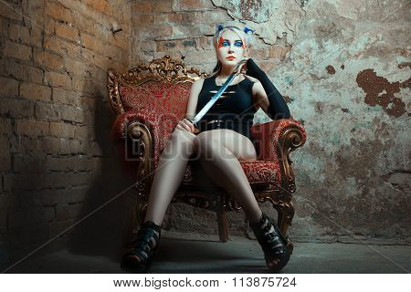 Girl Sits In A Chair, Holding  Sword His Hand.
