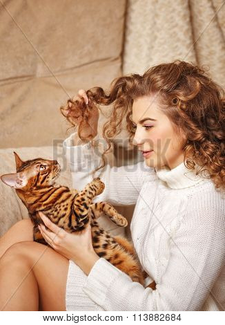 Girl Plays With A Cat.