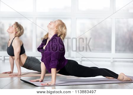 Senior Women Doing Upward-facing Dog Pose
