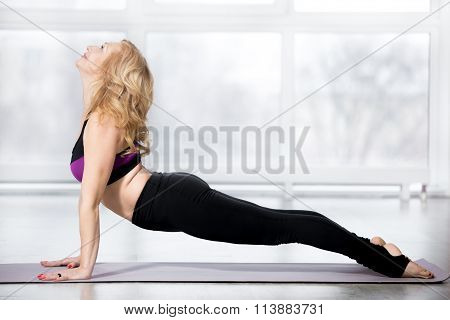 Senior Woman Doing Urdhva Mukha Svanasana