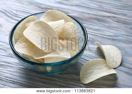 Potato chips bowl on blue