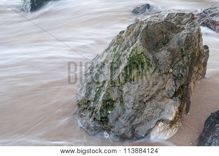 Flowing By The Rocks