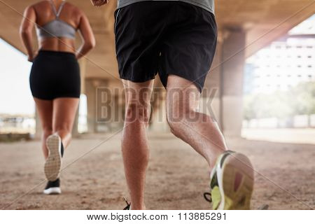 Two Young People Running Under The Bridge