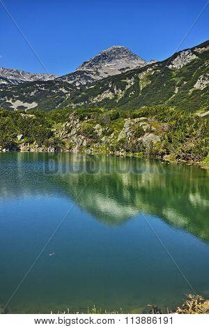 Reflection of Muratov peak in Okoto lake, Pirin Mountain