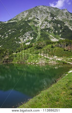 Reflection of Hvoynati peak in Okoto lake, Pirin Mountain