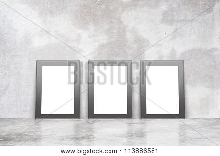 Blank Picture Frames On Concrete Floor In Empty Loft Rooml, Mock Up