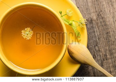 Yellow Cup With Linden Tea On The Table