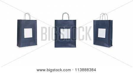 Black Paper Bags With Handles On A White Background