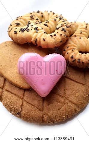 Sweet red marzipan heart and Crunchy fresh biscuits