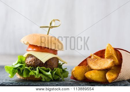 Delicious mini burger and chips