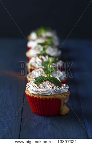 Muffins with cherry and pineapple standing in row