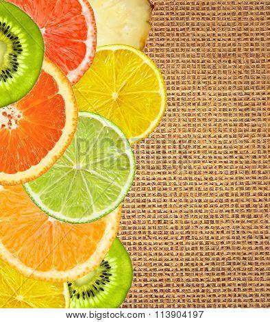 Beautiful Citrus Fruits Of Lemon, Orange, Grapefruit, Lime Over Burlap Background