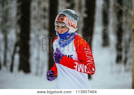 closeup face in frost elderly woman athletes running in cold weather in winter woods