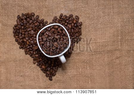 coffee beans on sackcloth white cup