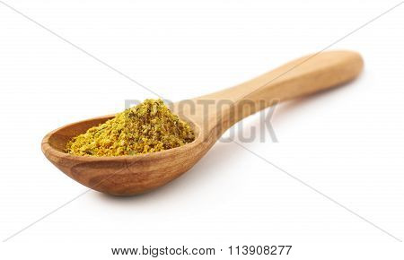 Wooden spoon of curry isolated
