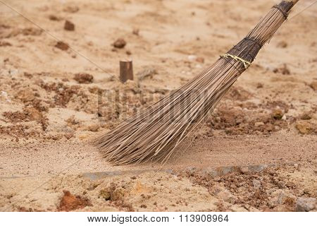 Coconut Broom Stick Surrounded By Dust