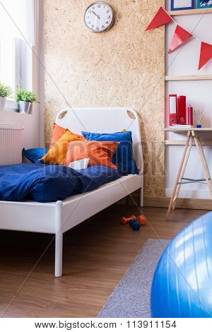 Single Bed With Blue Bedding