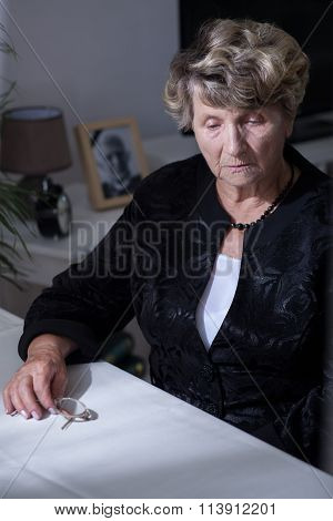 Bereaved Woman Sitting Beside Table