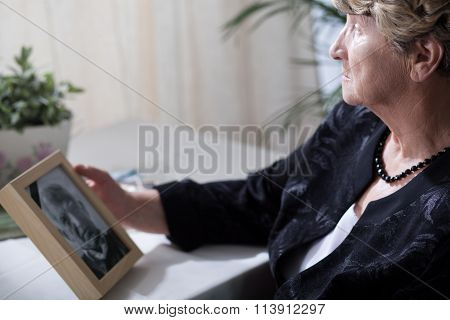 Senior Widow Reminiscing Her Husband