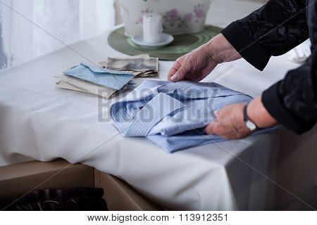 Bereaved Female Tidying Things