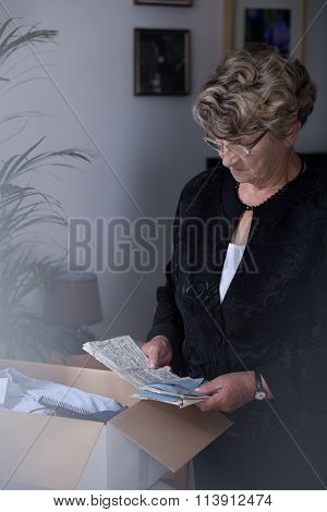 Grieving Woman With Souvenirs